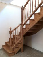 wood stair with decorative handrail