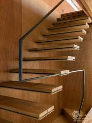 suspended stair with metal railing